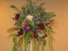 Escort card table finished with birch pole topirary of wild flowers, spiral eucalyptus and wild flowers