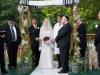 Earthy and simple free standing birch pole chuppah with ropings of gypsophilia and herbs