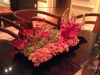 Low tin trays lush with succulents, snapdragons, Rothchild lilies and more for the sitting tables