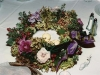 Seasonal holiday wreath arrangement for table with floating candles in center