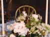 Handmade baskets full of peonies, roses, lace, veronica and more finished with crystal stick holders for elegance.