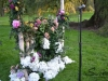 Handcrafted arbor of hydrangeas, roses, English ivy and more