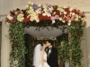 Victorian fluted column chuppah lush with flora